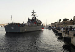 An Armed Forces of Malta ship carrying rescued migrants arrives at the AFM Maritime Squadron base at Haywharf in Valletta