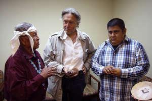 Lawyer Pierre Servan-Schreiber met two katsina priests when a katsina was returned to the Hopi in July 2013. © Survival