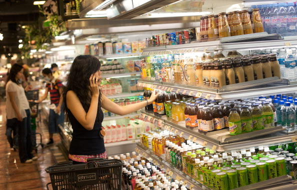 A consumer shops at a high-end supermarket in Hong Kong, Chi