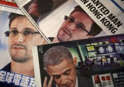 Photos of Snowden, a contractor at the NSA, and U.S. President Obama are printed on the front pages of local English and Chinese newspapers in Hong Kong in this illustration photo