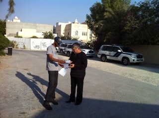 Nabeel Rajab is handed papers summonsing him for questioning