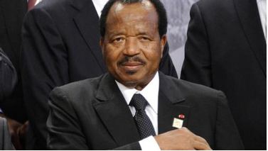 Photo of President Paul Biya getting ready to sign the bill against terrorism.
