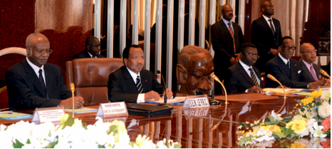 President Paul Biya in the middle and his council of ministers making top decisions about how to manage the crisis.