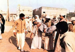 Demonstrators carrying the body of a fellow protester killed in clashes with security forces during the November 1979 unrest in Eastern Province, Saudi Arabia.