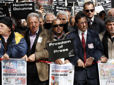 Journalists and activists participate in a rally calling for press freedom in central Ankara