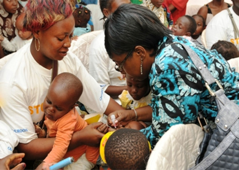 Representative of UNICEF in Cameroon Madame Félicité Tchinbindat administering vaccines to children in Kye-Ossi