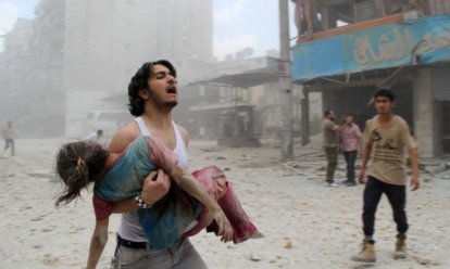 man trying to rescue child_syria
