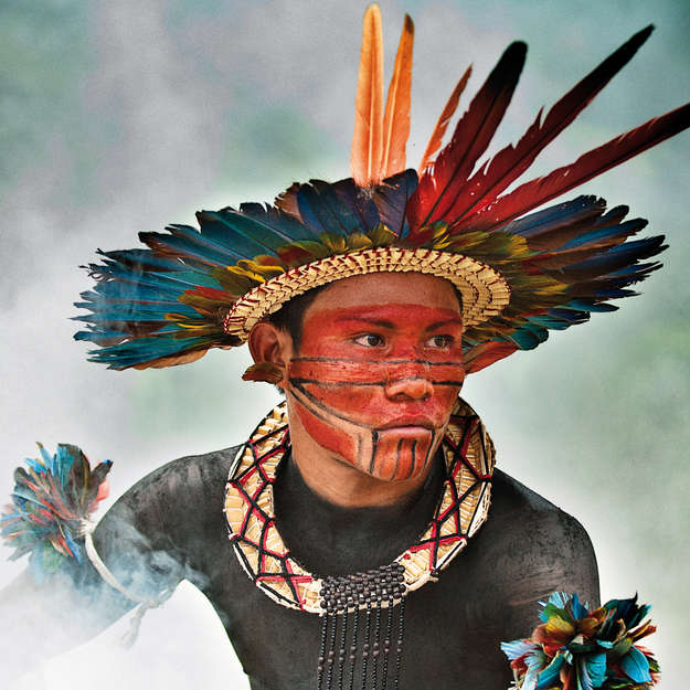The overall winning photograph by Giordano Cipriani is a stunning portrait of an Asurini do Tocantins tribesman in the Brazilian Amazon.