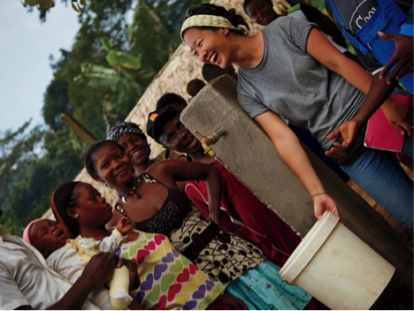 Sophia Sunwoo providing water to villagers at the Ebasse community in Cameroon.