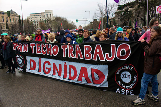 "Some demonstrators ask for ""Pan Techo Trabajo Dignidad"" (Bread Home Jobs Dignity)"