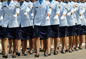 Women in uniform march during a ceremony