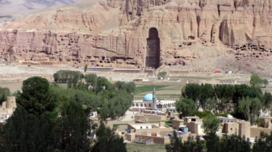 A view of Bamiyan with the empty cave that once hold the Buddah statue