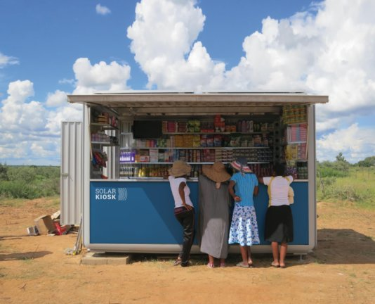 The SOLARKIOSK is used as a selling point for solar lanterns, replacing the dangers of paraffin lights with clean energy. It can also serve as a water purification station, a place to store medicines in a refrigerator, a copy, print and scan station and above all a charging point using the powerful solar array on its roof.