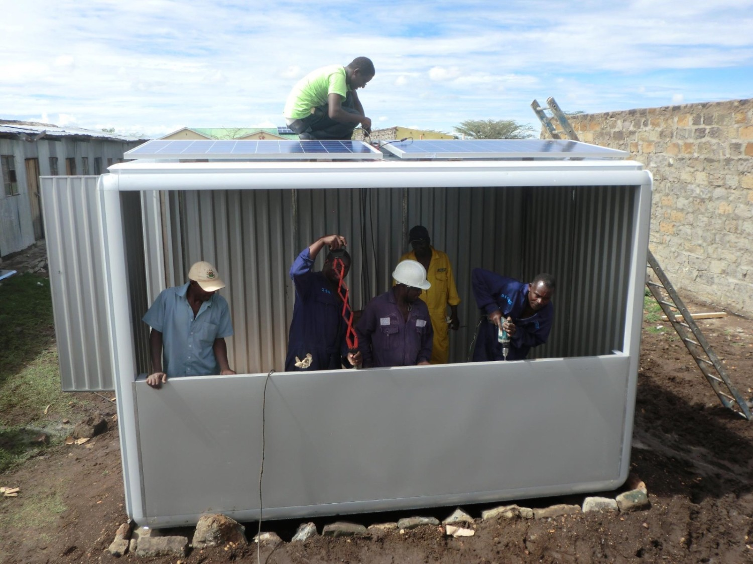 A team of workers in Kenya is working on putting up another SOLARKIOSK.