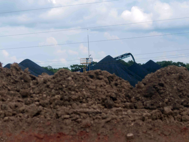 The hills of pet coke in the storage facility in Jaltipan