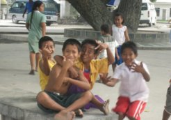 Children_in_Bairiki_Square,_Tarawa,_Kiribati