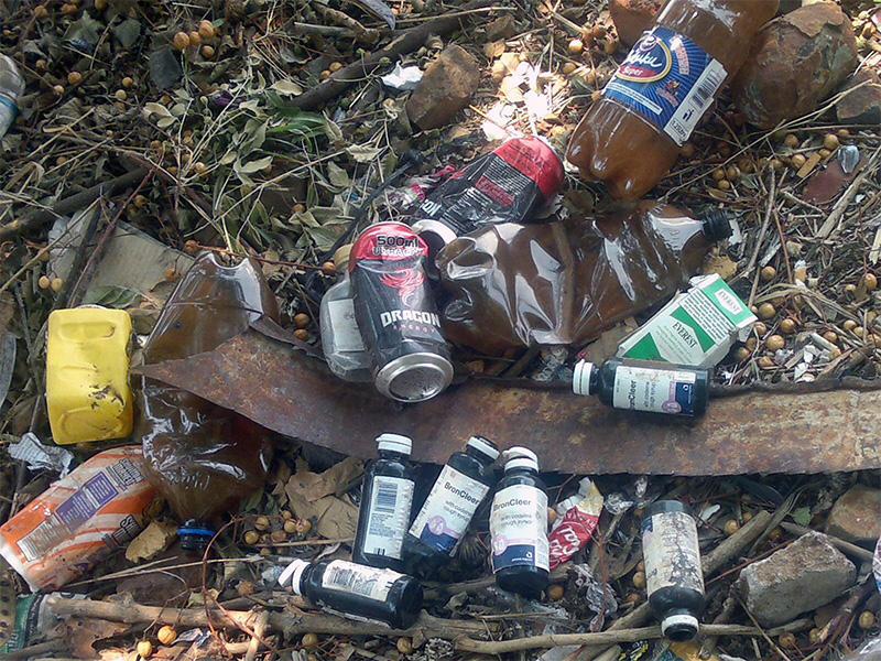 Discarded containers of Broncleer, Dragon energy drink , Chibuku<br /> Sorghum beer and Cigarettes in a backyard in Bulawayo