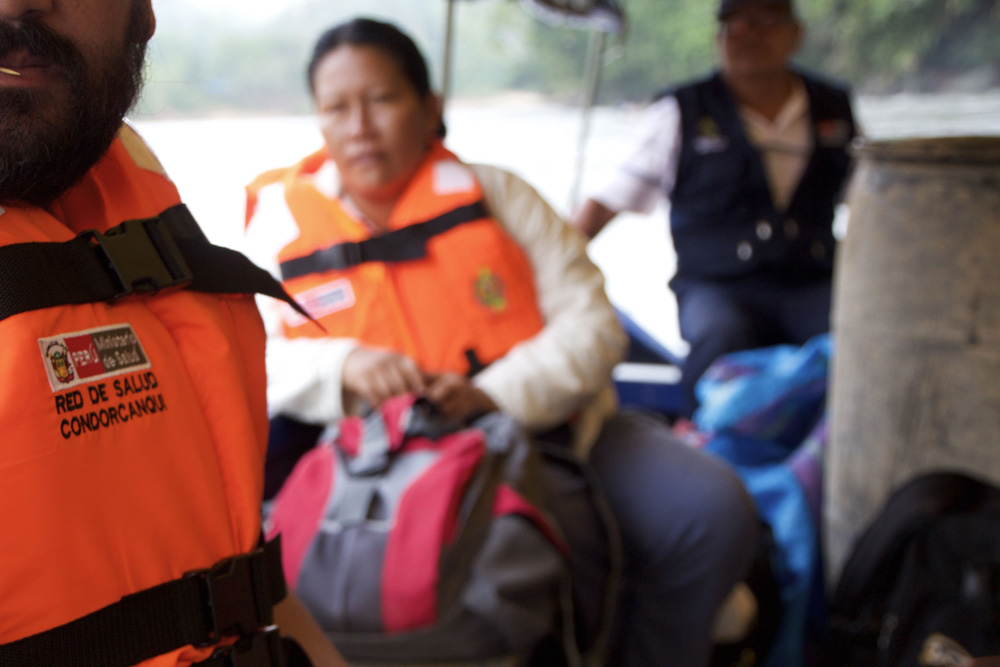 Peruvian medical staff travelling by boat on the Amazonas
