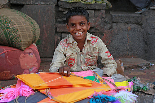 A kite seller at the Dili Diwarja Kite Market in India.