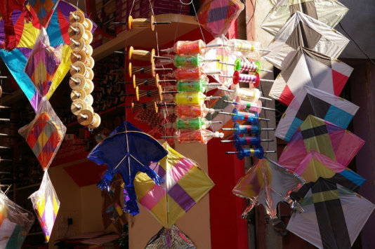Kite-flying during the Independet Day. The skies rustle with tissue paper and crack with polythene kites whipping against the wind. Here\'s the stock in trade of a kite shop in Nawalgarh.