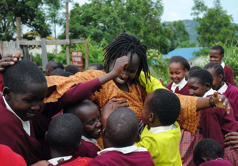 Kakenya enjoys a moment with some of the girls