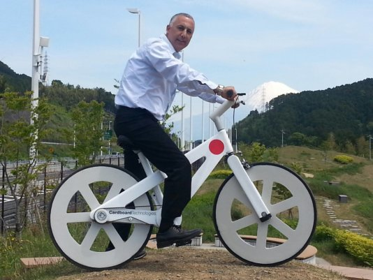 CEO Nimrod Elmish on one of his bikes in Japan.