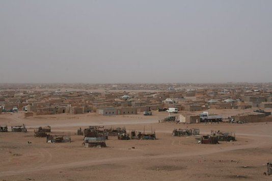El Aaiún refugee camp in Tindouf. In the foreground you can see goat farms made from metal.