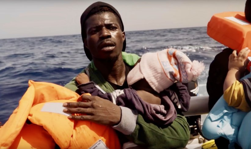 man with baby on rubber boat