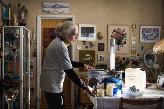 "Nattavaara, Gällivare, Sweden • Inga-Lillie Axelsson, 81, retired ""I've had around 30 to 40 short outages during the past six months. I keep the bathtub filled with water and make sure to keep canned food, as well as a battery-powered light and radio, and a gas stove. The worst part is that even the phone stops working; it worries me that if I fall I won't be able to call for help."""