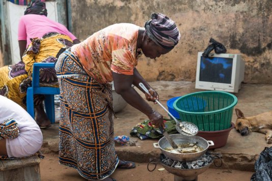 "Ama, Gomoa Fetteh – frying fish.<br /> ""There isn't enough fish now. So I get some of my fish from the cold store before I smoke and sell them."""