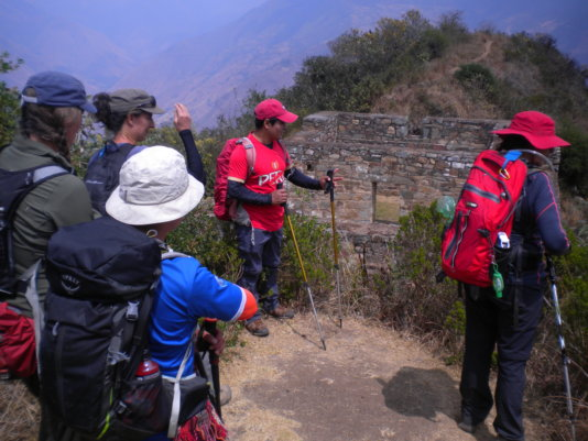 Juan (in red cap) giving a tour