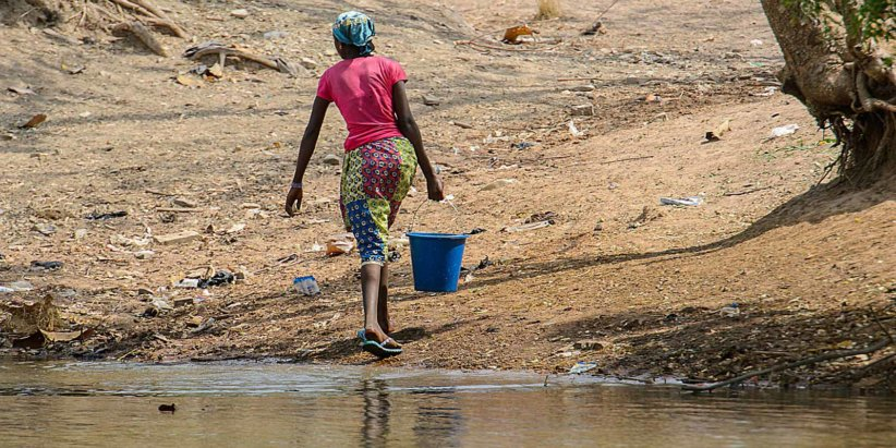 an-african-woman-struggling-with-the-lack-of-clean-water-in-africa